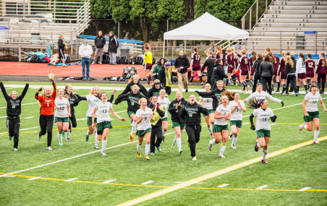 The girls soccer team celebrates their shoot-out win against Enumclaw which qualified them for state.
