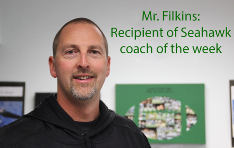 Head football coach receives award from NFL