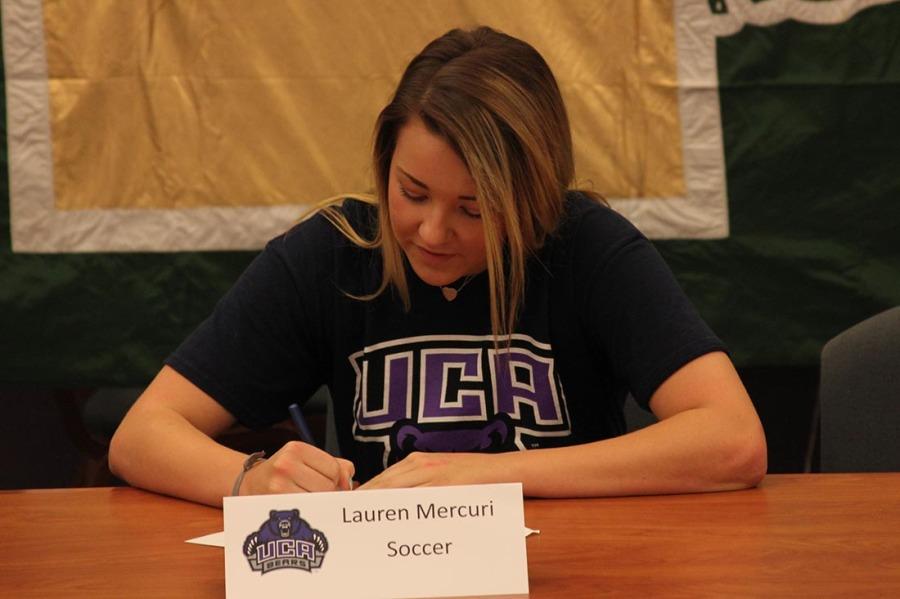 Soccer player Lauren Mercuri signing letter of intent to University of Central Arkansas.