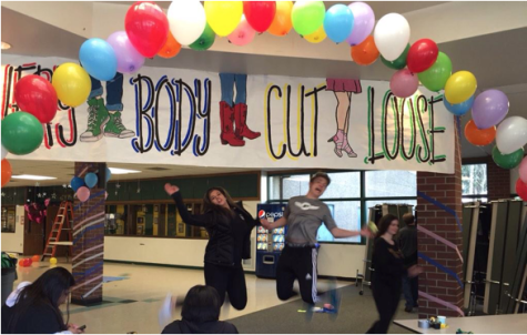 PHS students jump for joy while putting together the finishing touches of the Sadie Hawkins Dance.