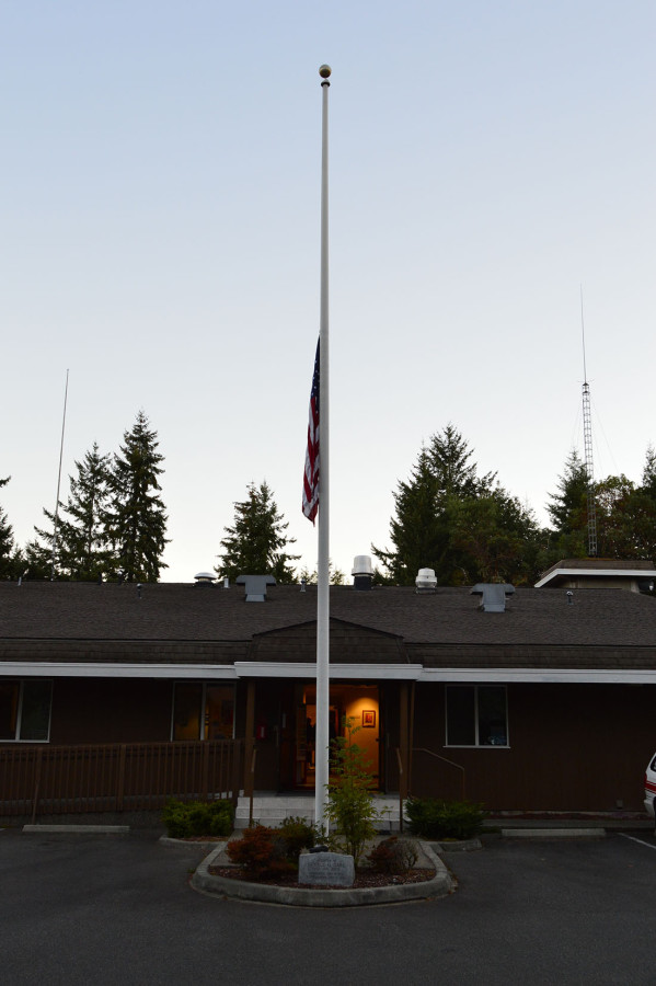 The flag will remain at half mast throughout the day at Gig Harbor Fire Station 5-1 on Kimball Drive.