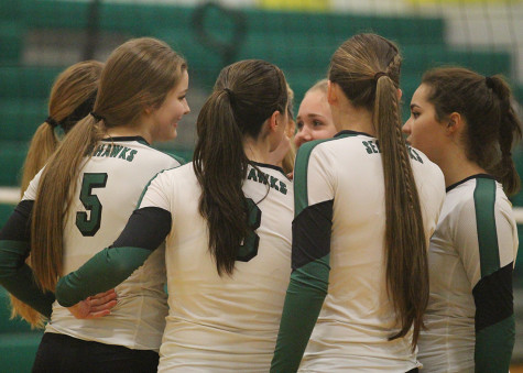 The senior girls in a team huddle before the match.