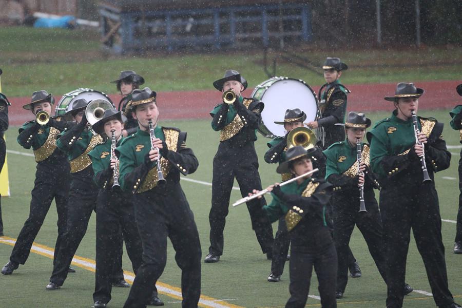 Pictured: Clarinets, Flutes, Drumline, High Brass.