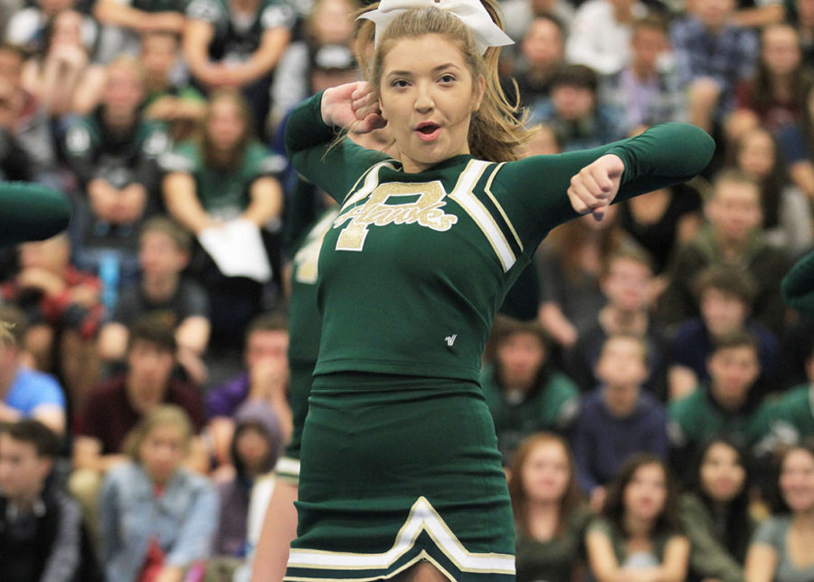 Varsity captain, Caroleann Tiedeman, cheers at a PHS assembly.