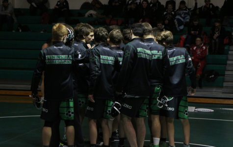 Wrestlers Huddling before the matches