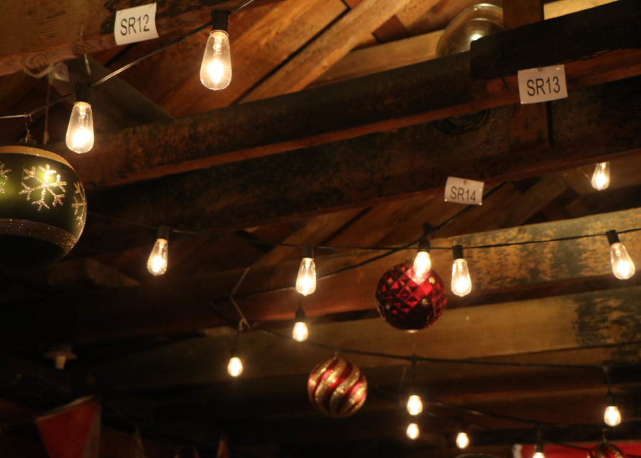 Ornaments and fairy lights hung from the ceiling