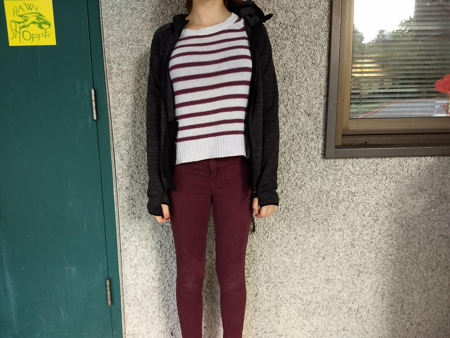 Victoria rocking a striped sweater and burgundy jeans.