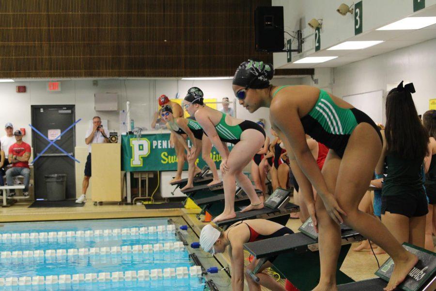 Girls swim and dive preparing to dive into the new season