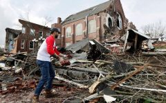 Resident helps to clean up rubble at the East End United Methodist Church after it was heavily damaged by storms Tuesday, March 3, 2020, in Nashville, Tennessee  (AP Photo/Mark Humphrey)