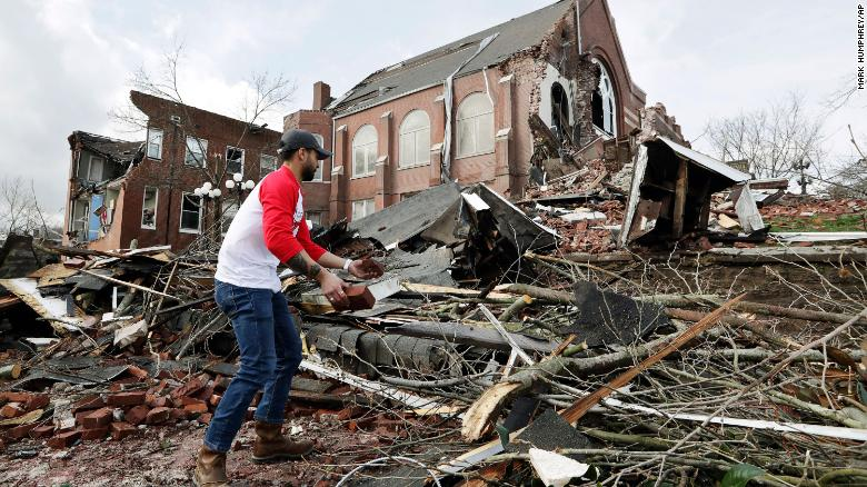 Resident+helps+to+clean+up+rubble+at+the+East+End+United+Methodist+Church+after+it+was+heavily+damaged+by+storms+Tuesday%2C+March+3%2C+2020%2C+in+Nashville%2C+Tennessee+%0A%28AP+Photo%2FMark+Humphrey%29