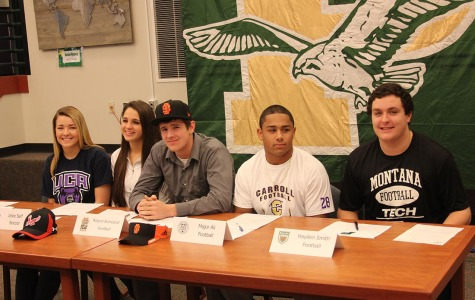 Five PHS students signing their letters of intent.