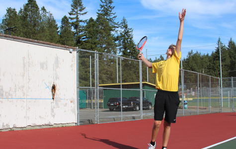 Quinlan Rogers warming up with a serve.