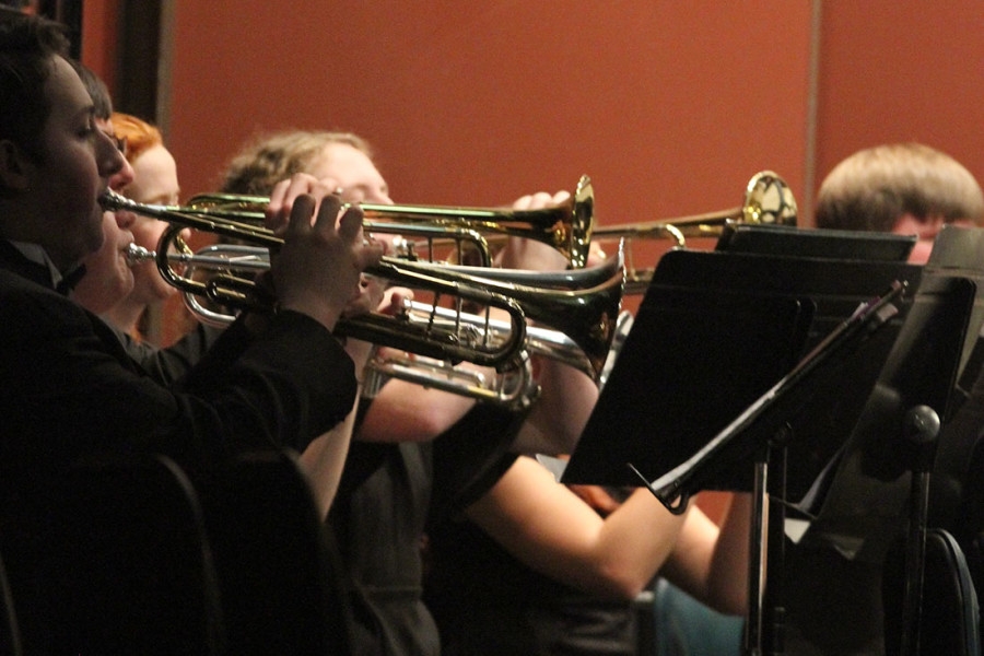The trumpet section hold their horns high during their first piece. (Pictured: Symphonic Band High Brass)