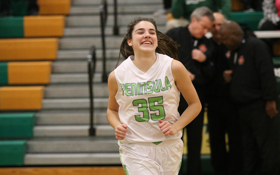 Belle Frazier heads off the court with a big smile.