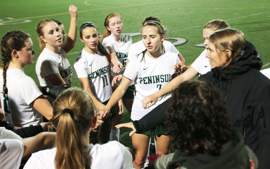 The Peninsula Ladies Soccer Team cheering before storing the field