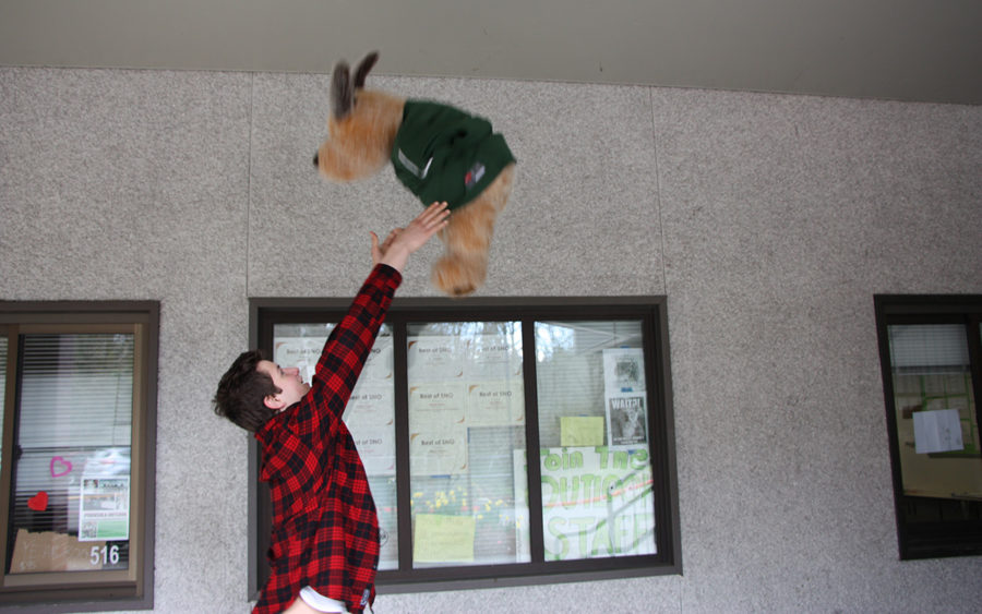 Daniel Fendel tossing a pup in the air like it is a child.