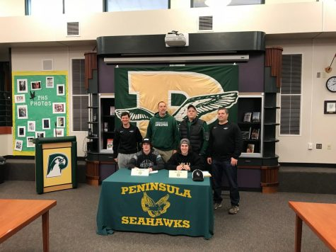 Two Senior Athletes Sign With College Programs